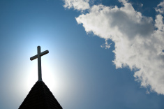easter-morning-with-the-sun-behind-a-church-steepl-cross1